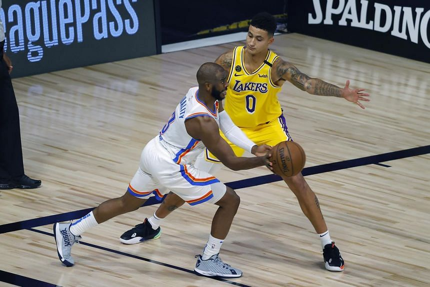 Kyle Kuzma #0 of the Los Angeles Lakers defends Chris Paul #3 of the Oklahoma City Thunder, on Aug 5, 2020, in Lake Buena Vista, Florida.