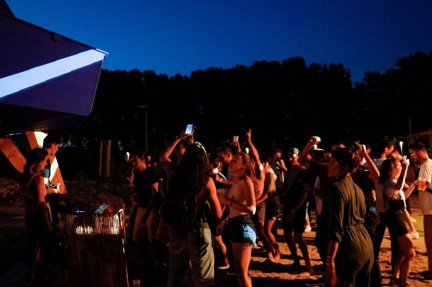 People at an open air party in Saint-Denis, north of Paris, on Aug 1, 2020.