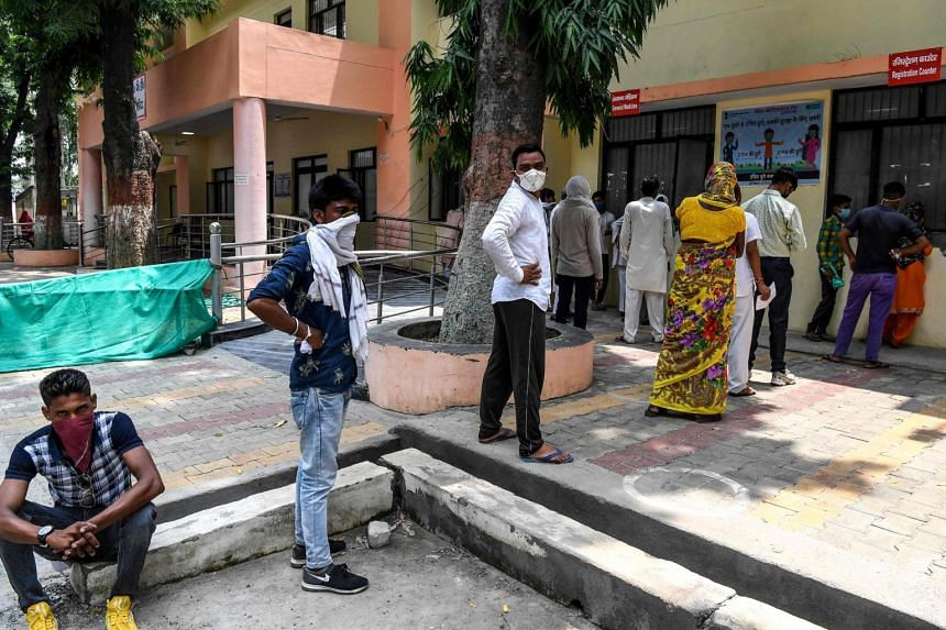 People queueing to get registered for Covid-19 tests at a hospital in Meerut, India, on Aug 4, 2020.