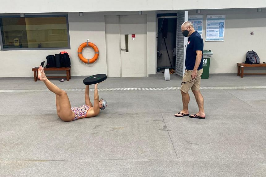 National swimming head coach and performance director Stephan Widmer with swimmer Amanda Lim at the OCBC Arena.