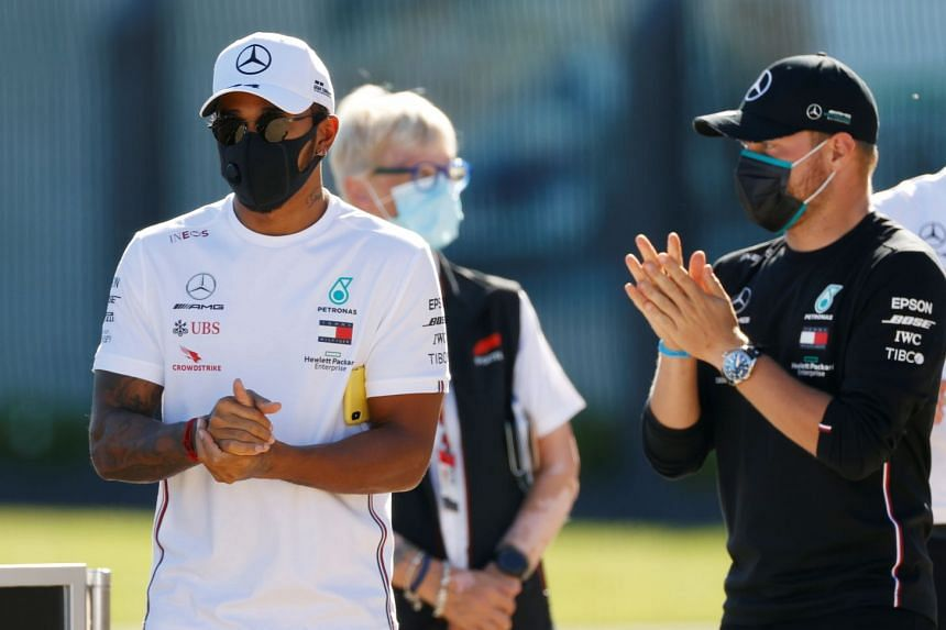 Mercedes' Lewis Hamilton and Valtteri Bottas wash their hands in the paddock ahead of the British Grand Prix.