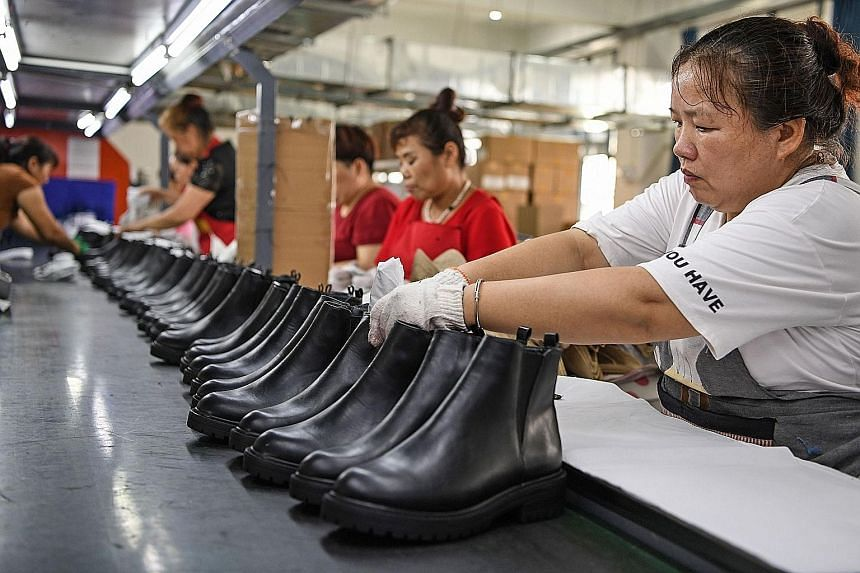 A shoe factory in Huainan, China's eastern Anhui province. Data out yesterday showed China registered a surprise jump in its July exports as the global economy slowly reopened after Covid-19 lockdowns. But analysts cautioned that the road ahead may s