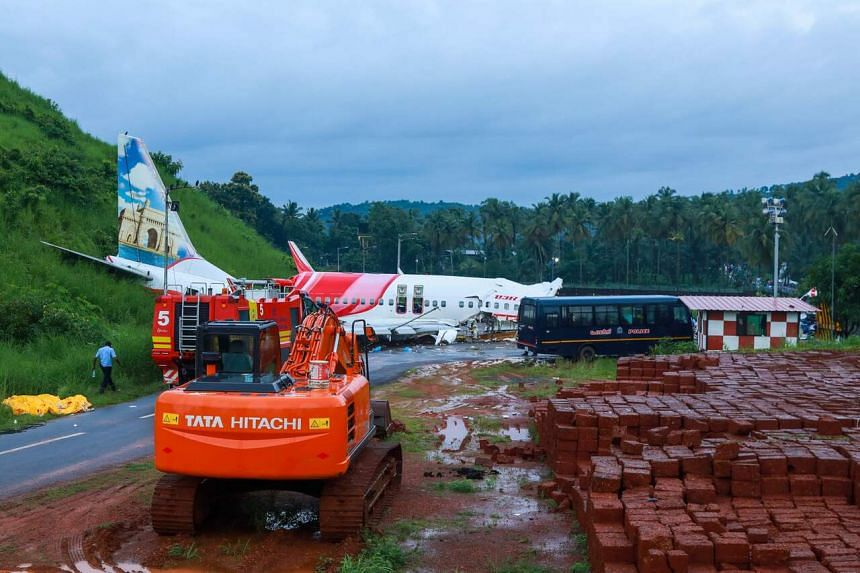 A man walking near the wreckage of an Air India Express jet at Calicut International Airport in Karipur, Kerala, on Aug 8, 2020.