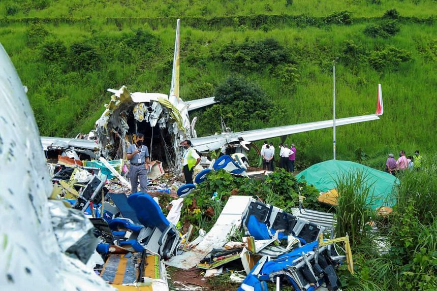 Officials inspecting the wreckage of an Air India Express jet at Calicut International Airport in Karipur, Kerala, on Aug 8, 2020.