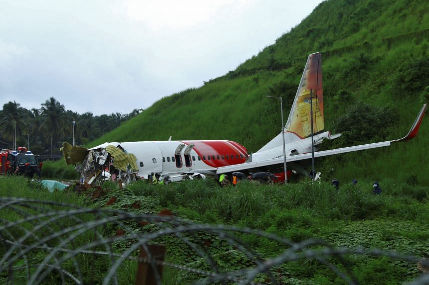 Officials inspecting the site where a passenger plane crashed in Karipur, Kerala, on Aug 8, 2020.