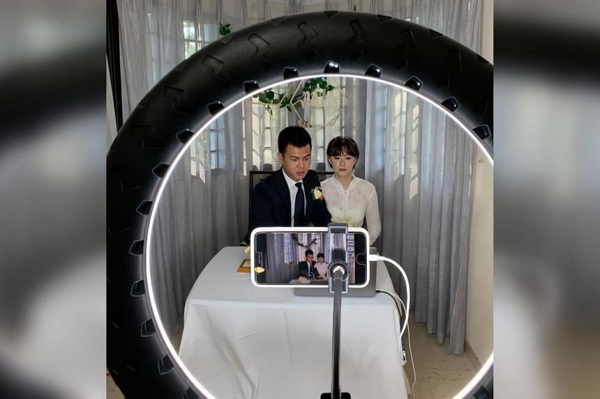 Ryan Liu and Zhuang Yaqi live-streamed their solemnisation ceremony from their home.