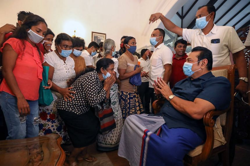 Sri Lankan Prime Minister-elect Mahinda Rajapaksa, who is the President's brother, greeting supporters at his home yesterday after the victory.