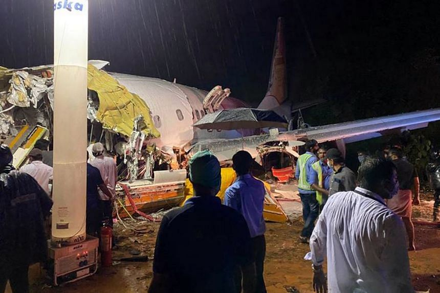 The plane, carrying 190 passengers, crashed after it overshot the runway amid very heavy rainfall.