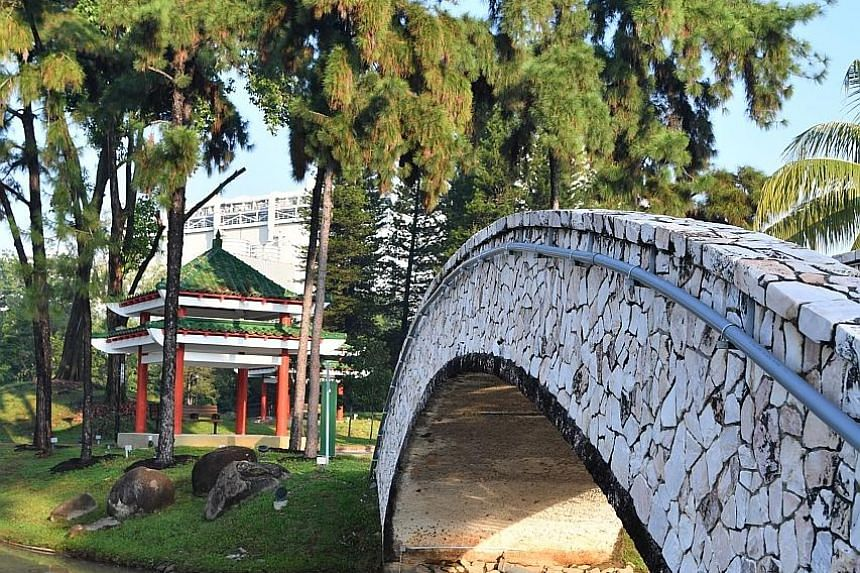 The centrepiece of Marsiling Park is its stone bridge flanked by Chinese pavilions (above). The park also has a butterfly-shaped playground, surrounded by plants that attract butterflies (photo taken before the Covid-19 pandemic).