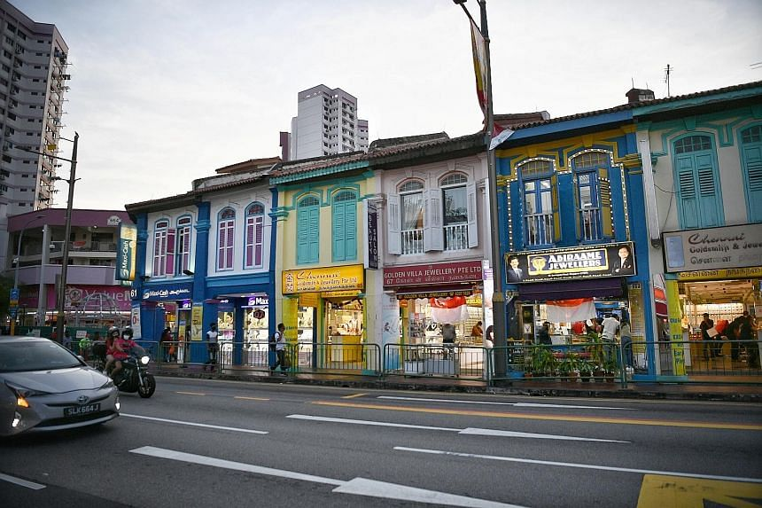 Gold shops in Little India yesterday. Gold shops have seen a drop in customers of at least 30 per cent, as gold prices soared past the key US$2,000 mark for the first time in history on Tuesday.