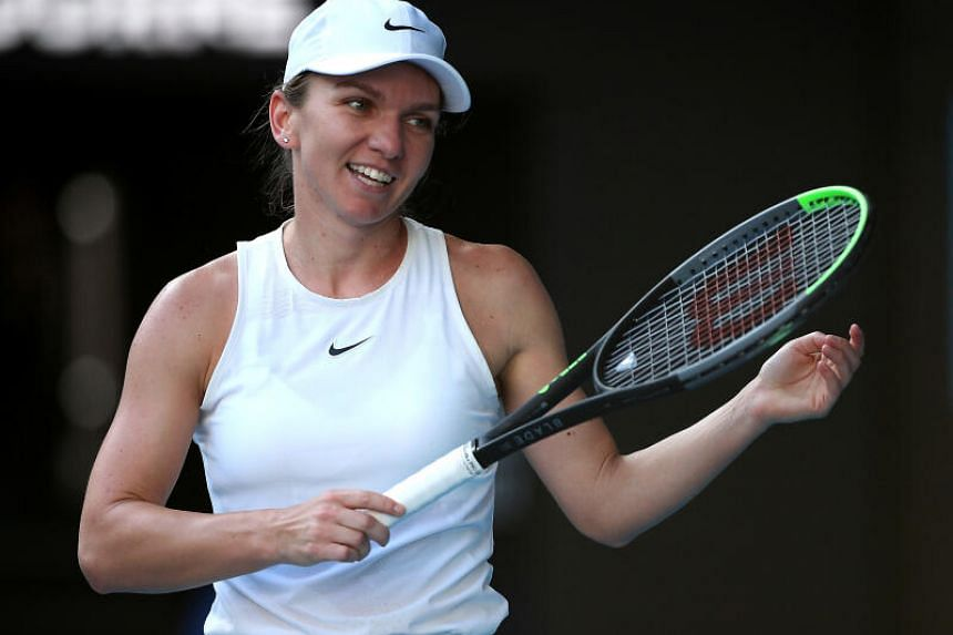 Top seed Halep makes 2nd round of Prague Open