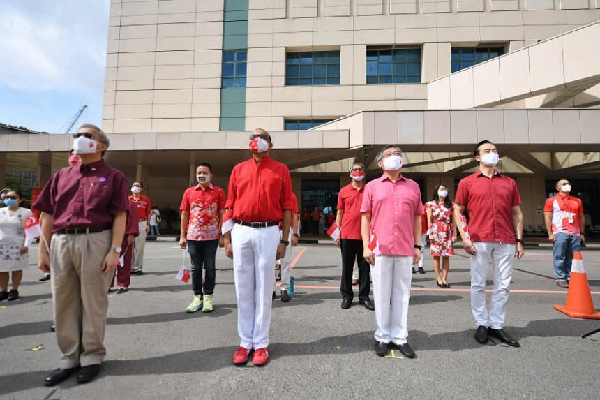 Anthem moment and flag raising ceremony at the National Centre for Infectious Diseases on Aug 9, 2020.
