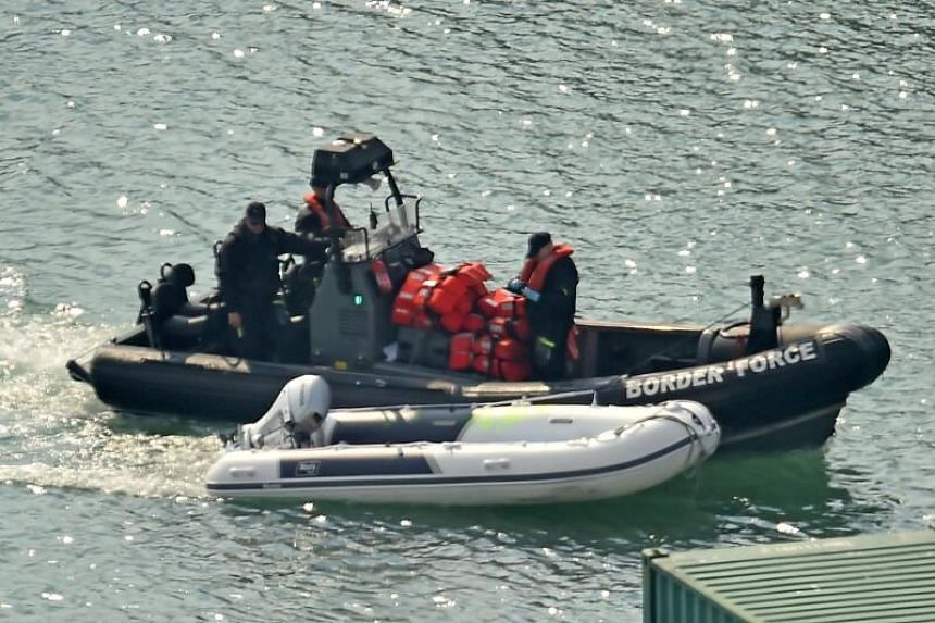 A dinghy and life-jackets, believed to have been taken from migrants, arrive in the port of Dover, in England, on Aug 9, 2020.