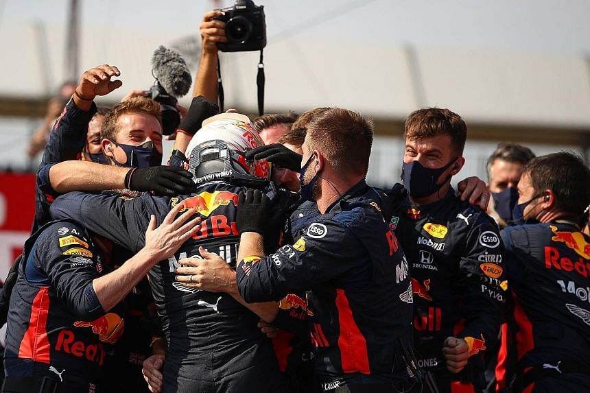 Max Verstappen celebrates an unlikely victory at Formula One's 70th Anniversary Grand Prix with his Red Bull crew. The 22-year-old Dutchman had never won at Silverstone and started fourth on the grid but still managed to end Mercedes' unbeaten start
