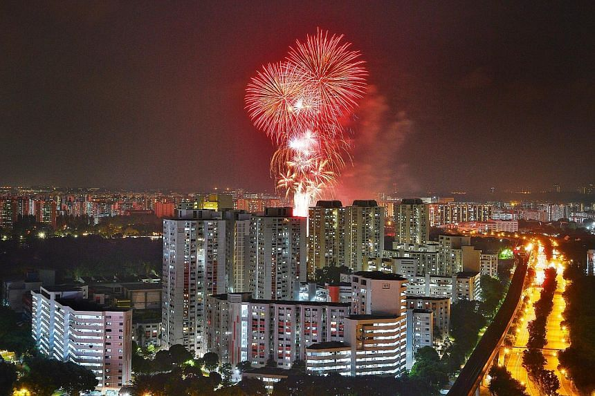 The fireworks over Jurong Lake last night, as seen from J Gateway condominium. This year's National Day fireworks were set off at 10 locations as celebrations took place all over Singapore rather than at a central spot.