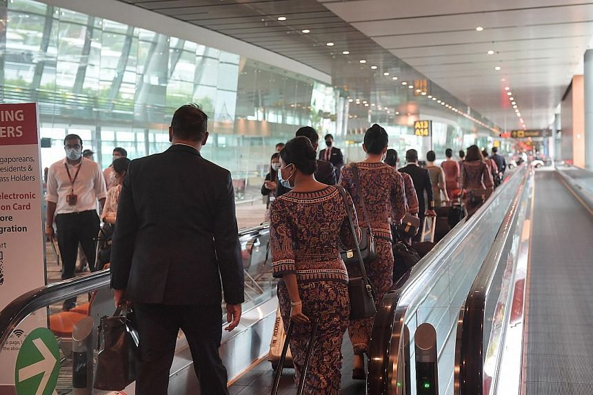 Singapore Airlines crew arriving at Changi Airport in June. The no-pay leave scheme and letting staff seek secondary employment are part of several cost-cutting measures the SIA Group has introduced as the pandemic rages on. ST PHOTO: ALPHONSUS CHERN
