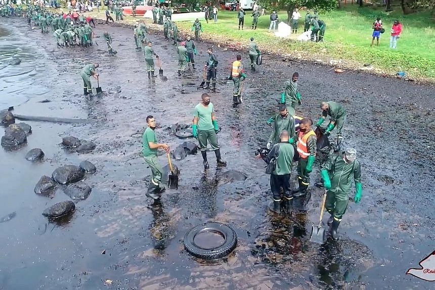 A clean-up crew confronting the oil spill in Riviere des Creoles on Saturday. Thick muck has inundated Mauritius' unspoiled lagoons, marine habitats and beaches.