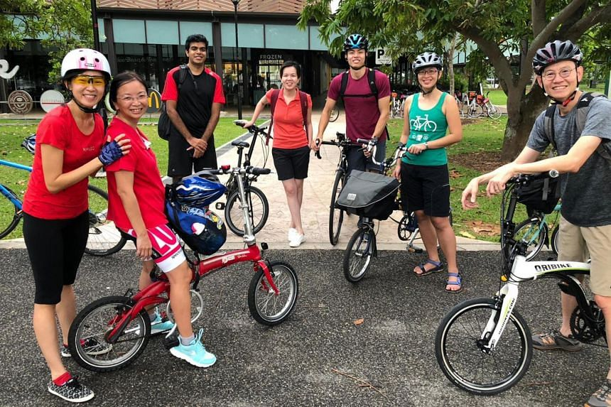 URA CEO Lim Eng Hwee (right) and his staff during a cycling outing.