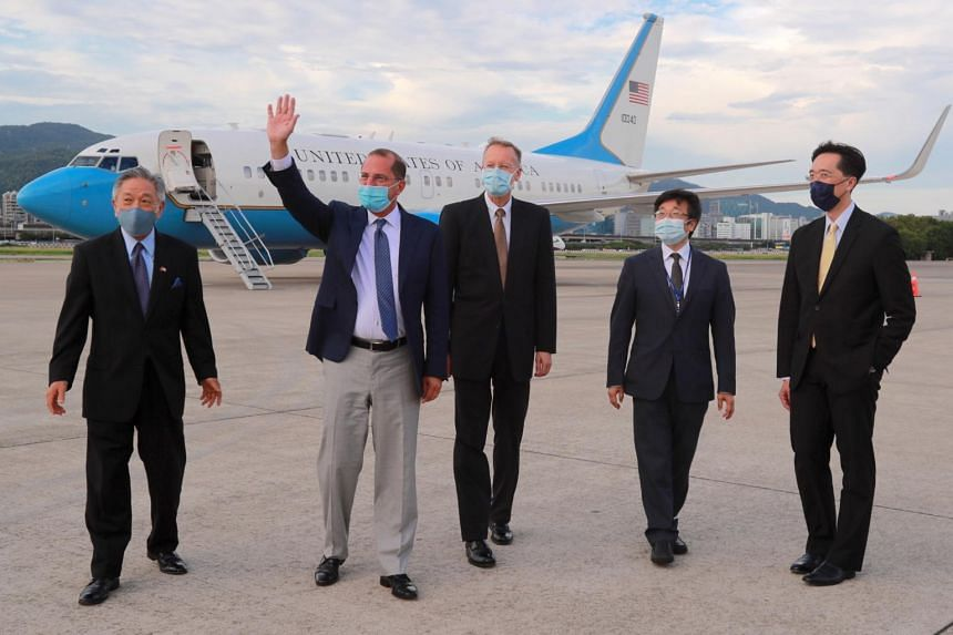 US Health Secretary Alex Azar (second from left) waving upon his arrival at Taipei Songshan Airport in Taipei, Taiwan, on Aug 9, 2020.