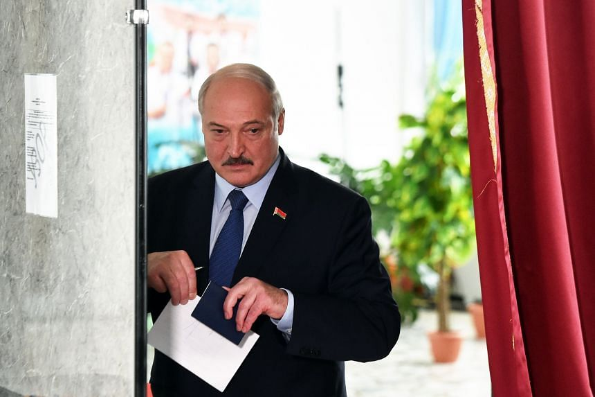 Belarus' President Alexander Lukashenko votes at a polling station during the presidential election in Minsk, on Aug 9, 2020.