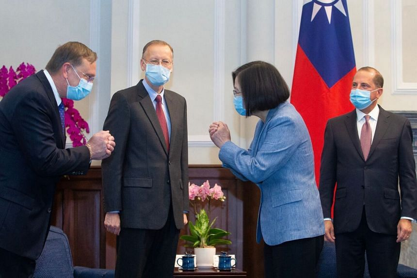 Taiwan's President Tsai Ing-wen (second from right) gestures to a US official (left) as US Secretary of Health and Human Services Alex Azar (right) and director of the American of Institute in Taiwan, Brent Christensen (second from left), look on dur