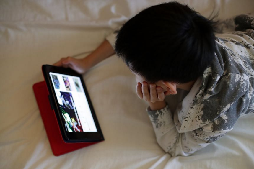 A child watches a video at home on April 25, 2020.