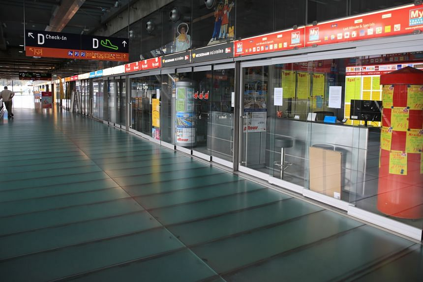 Bureaus of last-minute travel agents are seen closed at the Cologne-Bonn Airport in Cologne, on July 28, 2020.