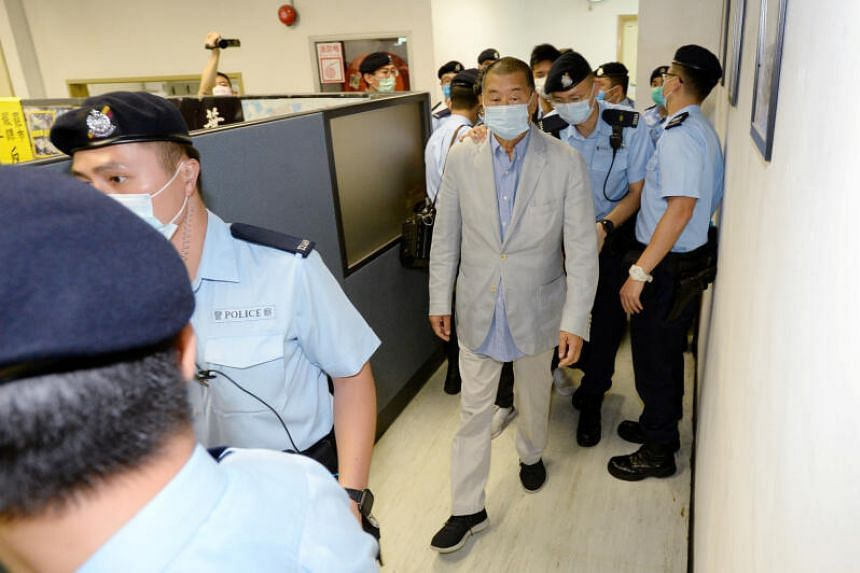 Apple Daily founder Jimmy Lai escorted by police at the tabloid's office in Hong Kong on Aug 10, 2020.