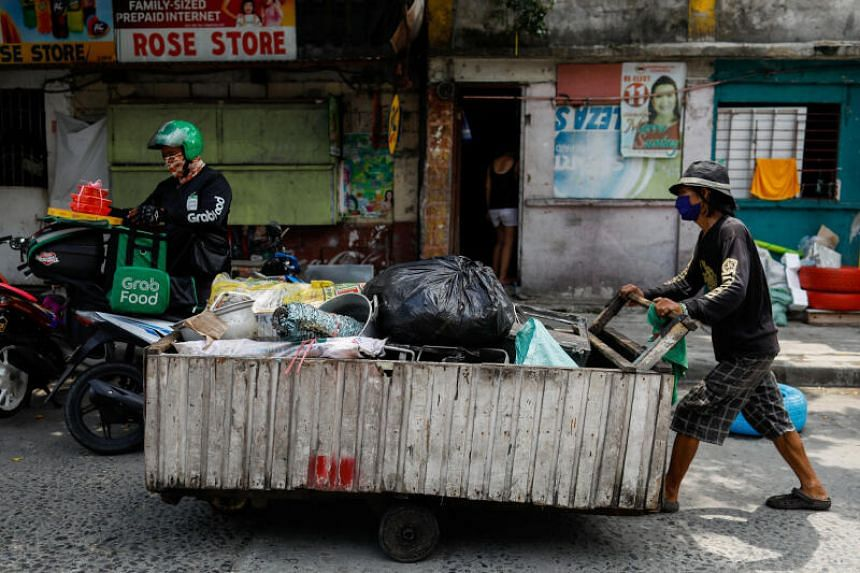 Waste picker Virgilio Estuesta with his cart in Quezon City, the Philippines, on July 7, 2020.