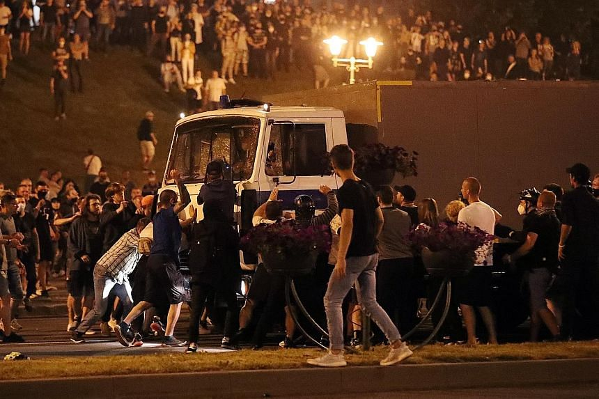 A police truck, carrying demonstrators, making its way through a crowd of protesters in Minsk on Sunday after polling stations closed following the Belarus presidential election. Thousands of people took to the streets in protest after President Alex