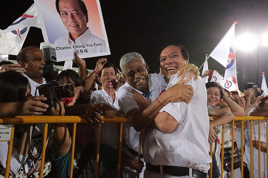 A supporter hugging Mr Chong, then candidate for Punggol East SMC, at Bedok Stadium in 2015. He won with 51.77 per cent of the vote.