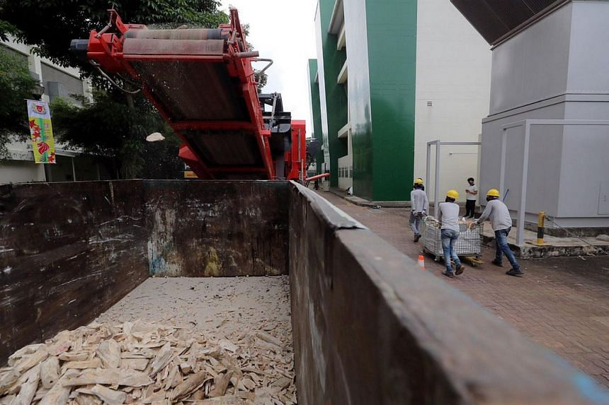 Elephant ivory seized from various detections in recent years are crushed by a rock-crusher machine on Aug 11, 2020.