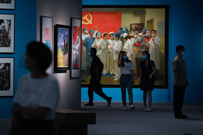Among the large canvases on display, a painting shows an ecstatic nurse reading a letter from President Xi to her colleagues.