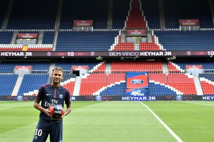 Neymar poses during his official presentation at the Parc des Princes stadium in Paris, on Aug 4, 2017.