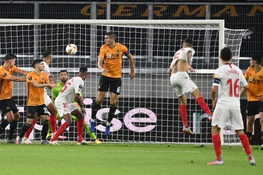 Sevilla's Lucas Ocampos scores his team's first goal against the Wolverhampton Wanderers.