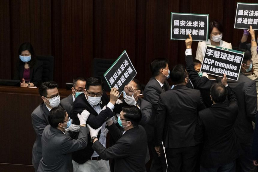 Hong Kong's pro-democracy legislators protest the imposition of the national security law during a meeting on May 22, 2020.