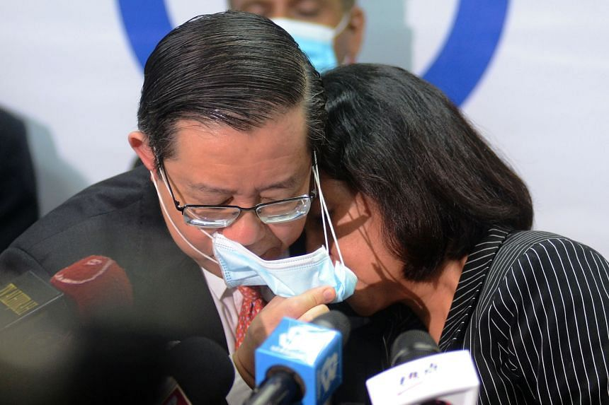 Lim Guan Eng and his wife Betty Chew after their court appearance in Penang yesterday. PHOTO: BERNAMA