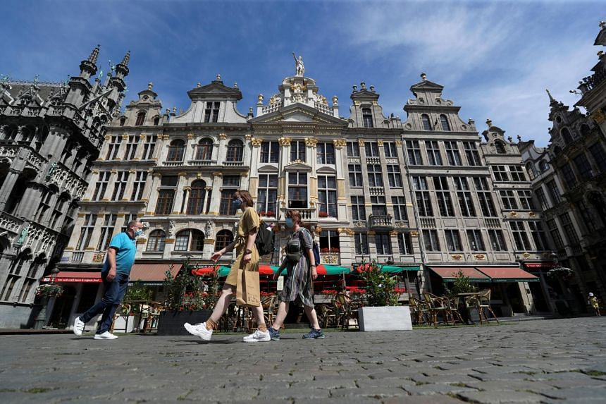 People walking at Brussels Grand Place in Belgium, on Aug 6, 2020.