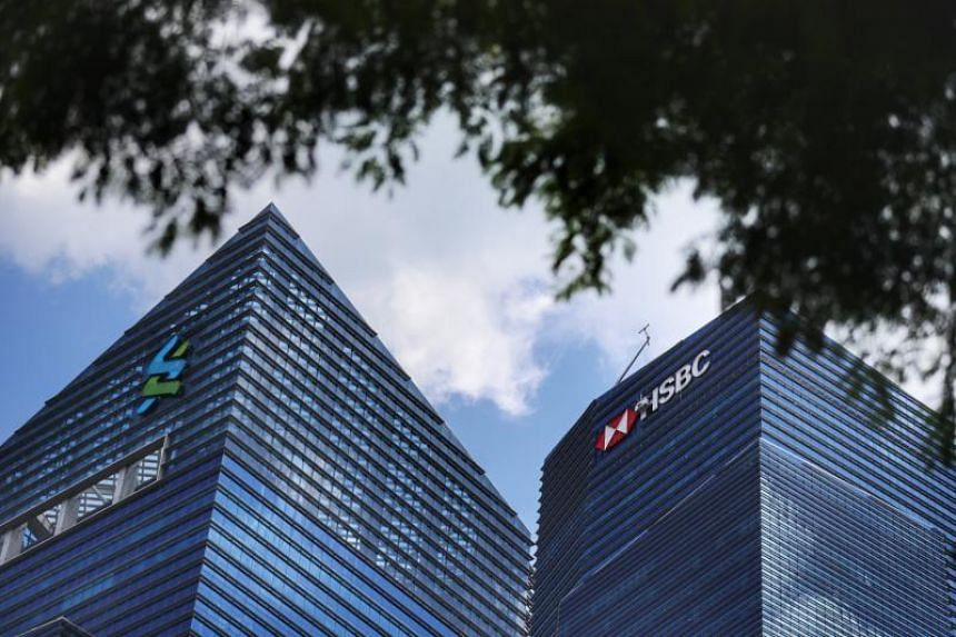 A view of Standard Chartered and HSBC at Marina Bay Financial Centre on Feb 25, 2020.
