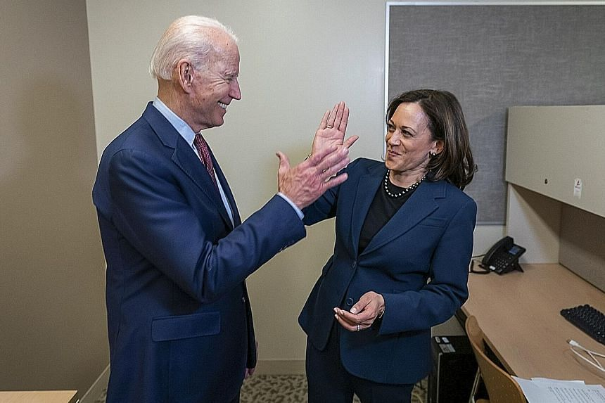US Democratic presidential candidate Joe Biden and Senator Kamala Harris high-fiving in an undated photo. They were set to make their first campaign appearance together yesterday in Wilmington, Delaware, as the race for the White House enters a more