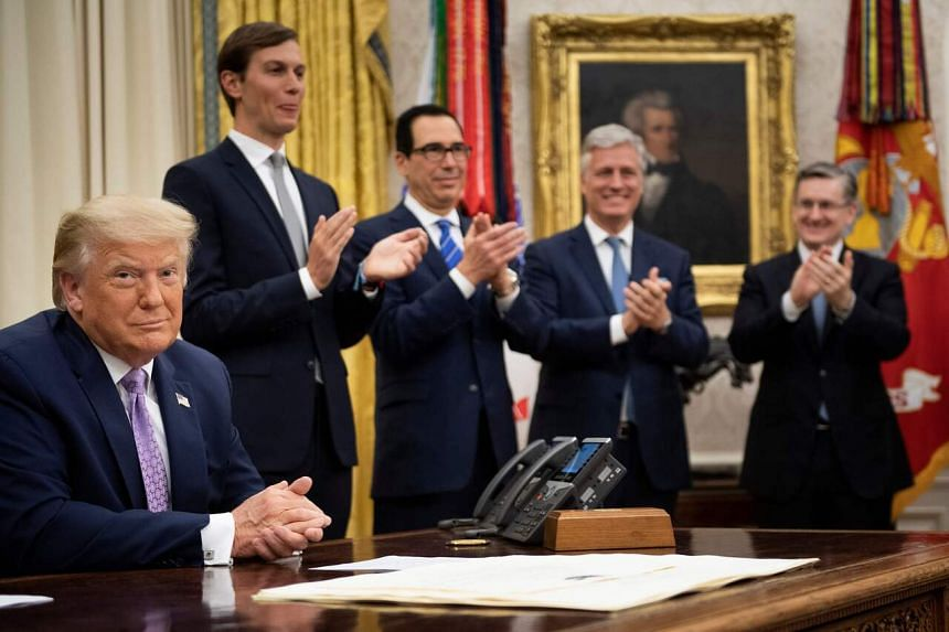 (From left) US President Donald Trump, with senior advisor Jared Kushner, Treasury Secretary Steven Mnuchin and National Security Advisor Robert O'Brien, announcing the agreement between Israel and the UAE at the White House on Aug 13, 2020.
