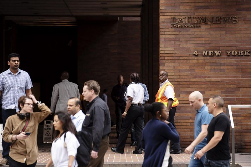 Pedestrians outside The New York Daily News headquarters in Manhattan on July 23, 2018.