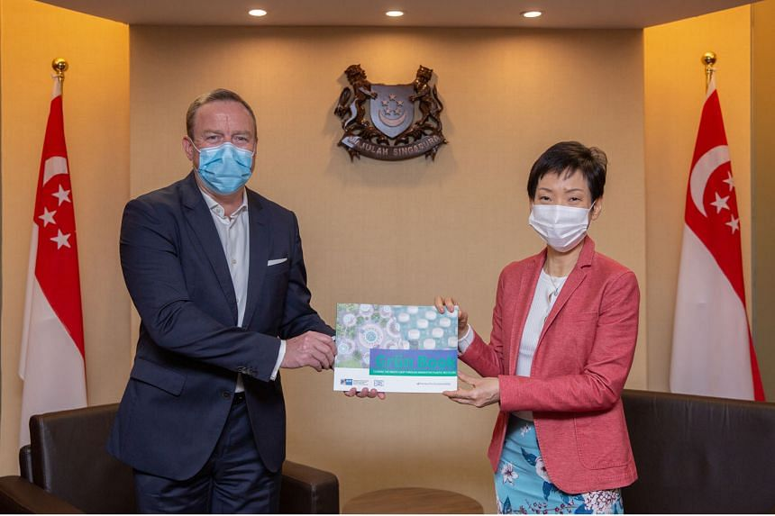 Mr Jens Ruebbert, president of the Singaporean-German Chamber of Industry and Commerce, and Minister for Sustainability and the Environment Grace Fu at the launch of Grun Book. PHOTO: MINISTRY OF SUSTAINABILITY AND THE ENVIRONMENT