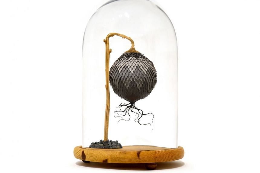 Noreen Loh's fantastical species of flora, blooming synthetically in bell jars.