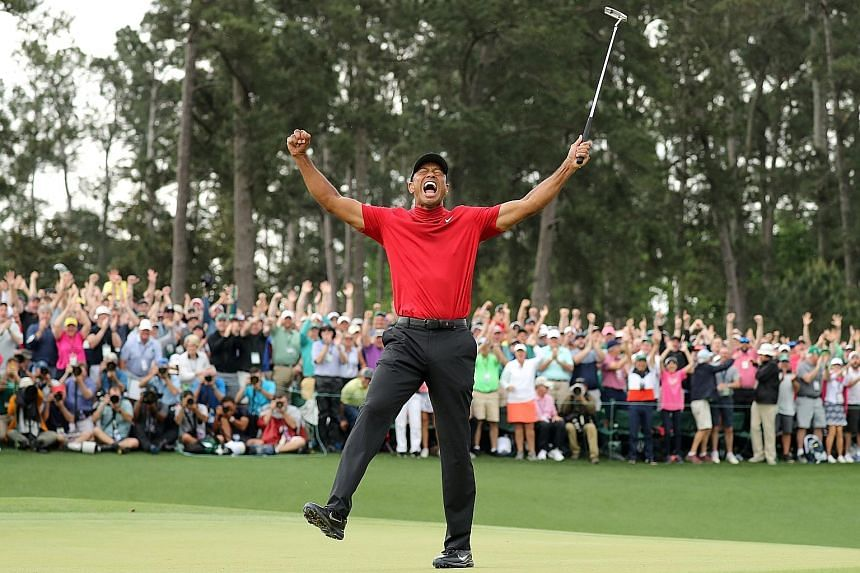 Huge crowds were on hand to cheer Tiger Woods as he celebrated last year's Masters win. Fans will be barred from this year's delayed edition in November due to Covid-19.