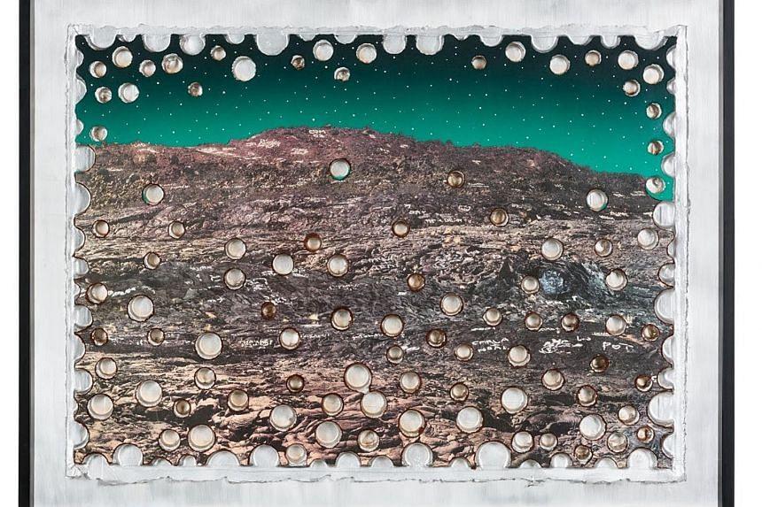 Ashley Bickerton's sphere-studded mountains.