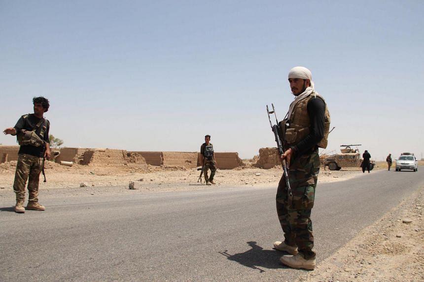 Security officials patrol on Helmand-Kandahar highway, in Afghanistan, on Aug 11, 2020.