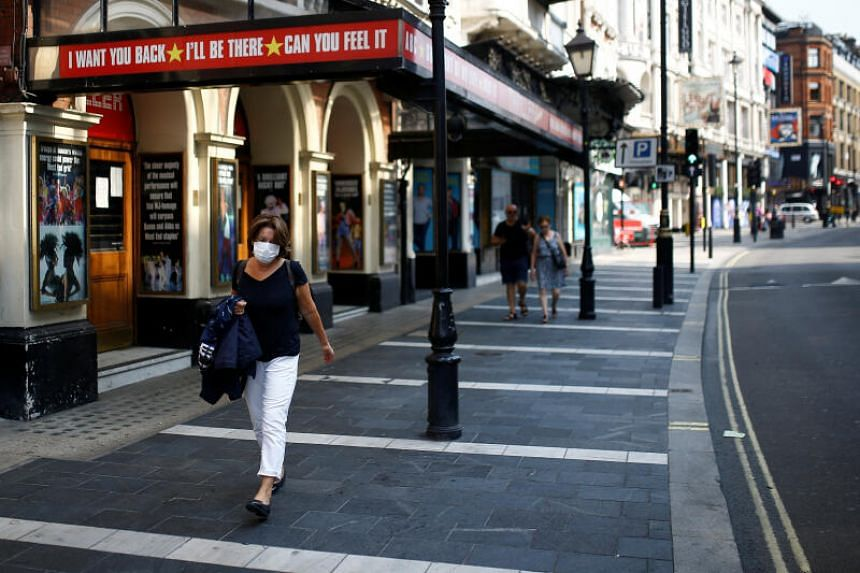 A woman walks past the Lyric Theatre at London's West End, on Aug 13, 2020.