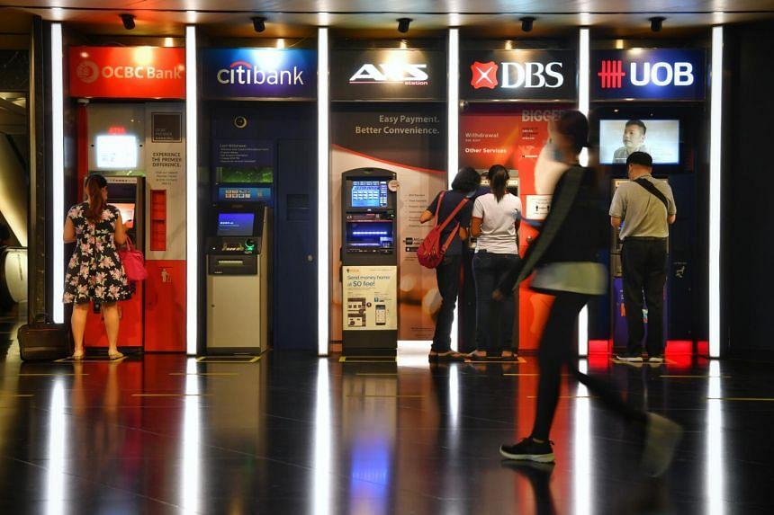 DBS, OCBC and UOB ATMs at Tang Plaza.