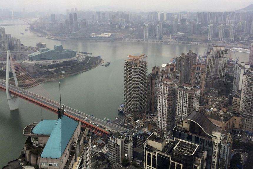 The junction of Yangtze River and Jialing River is pictured in Chongqing, China, on Jan 25, 2016.